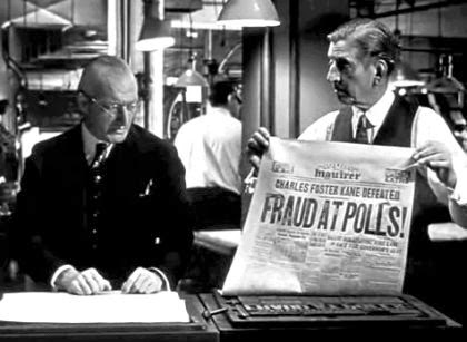Screen shot of Citizen Kane in which one person holds up a newspaper mock-up for another. The headline reads: FRAUD AT POLLS!