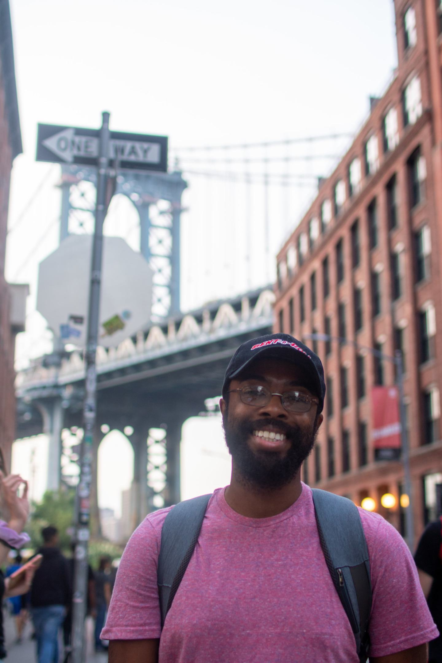 Chris standing in front of the Manhattan Bridge in New York