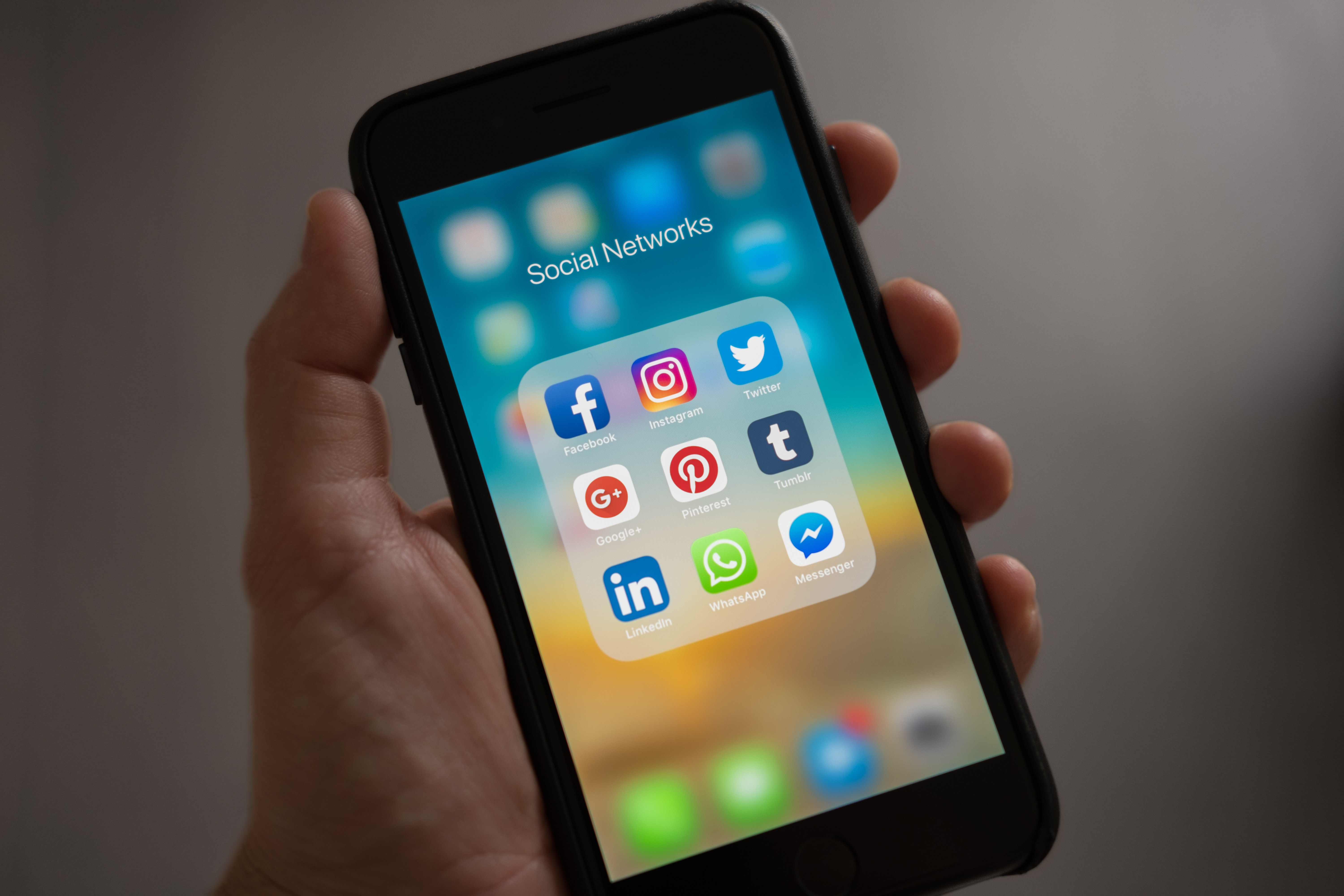 A photo of a phone screen showing various social media icons.