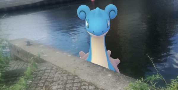 Lapras in the river peaking over the pathway
