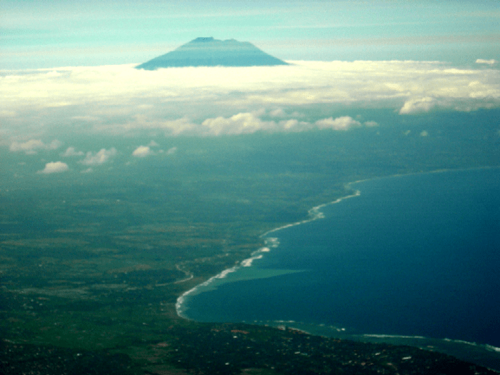 Gunung Agung photographed from about 60 km to the south during an overflight of the main tourist areas of Bali. Except for the extreme bottom of the picture, the entire plain visible is covered in ignimbrite deposits from the Batur I eruption of about 29,000 BP (WikiMedia Commons)