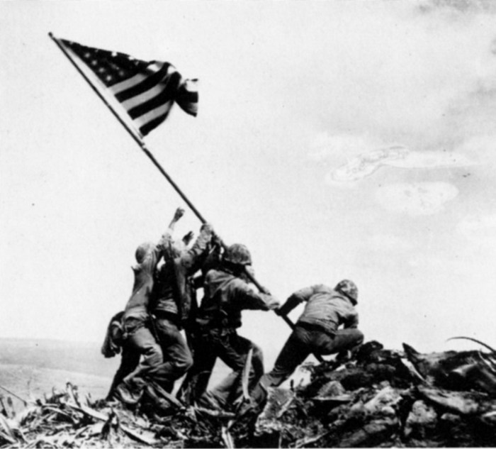 "As we raise the flag for Ioto, formerly known as Iwo Jima, we cannot fail to mention ""Raising the Flag on Iwo Jima"", the historic photograph taken on February 23, 1945, by Joe Rosenthal. It was a re-enactment, it does not represent the actual moment the island was captured earlier the same day and wasn't even the first ""Star Spangled Banner"" to be flown at the mountain summit."