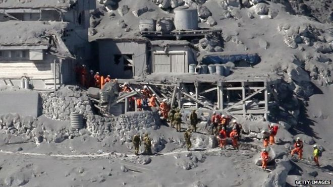 Rescue workers at Japan's Mt Ontake, September 2014 (Getty Images)