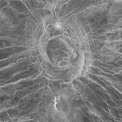 Vencor, a smaller corona (30 km across) with an arachnoid
