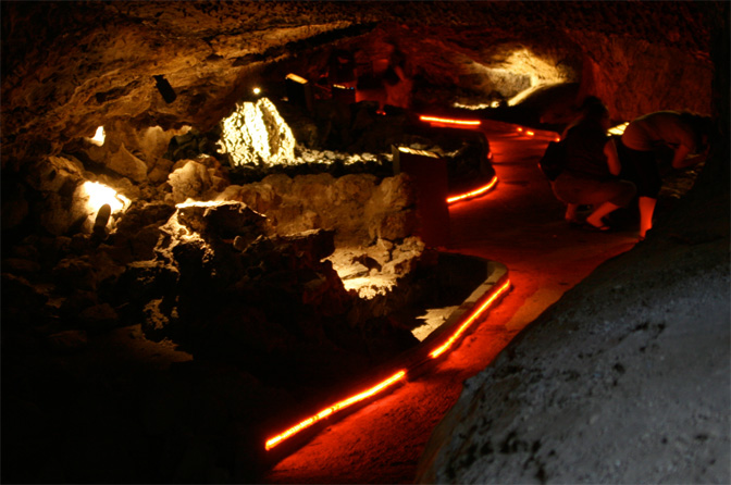 Illuminated lava tube cave. (wikimedia commons)