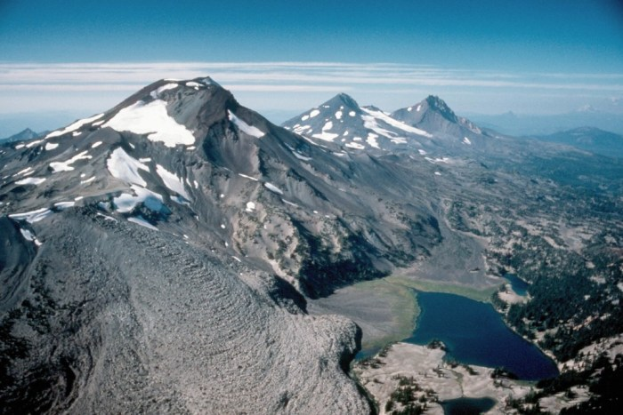 The Three Sisters volcanoes in Oregon from left to right they are Charity (South Sister), Hope (Middle Sister) and Faith (North Sister). Below South Sister is scenic Green Lake and on her flank the massive Newberry lava flow. (CVO)