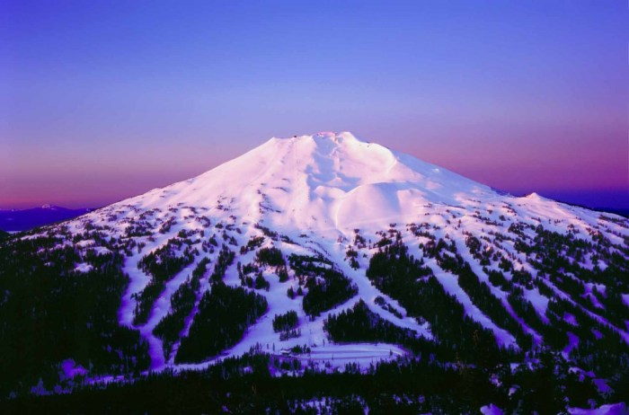 Mount Bachelor. The present-day development into a popular ski resort with multiple pistes on her slopes are evident, yet her resent volcanic origin is unmistakable. (columbusskiclub.org)
