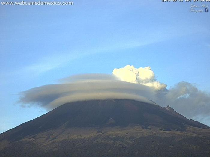 Lenticular clouds together with eruptive activity at Popocatepetl shortly after local dawn on August 16th this year (Webcams de Mexico)