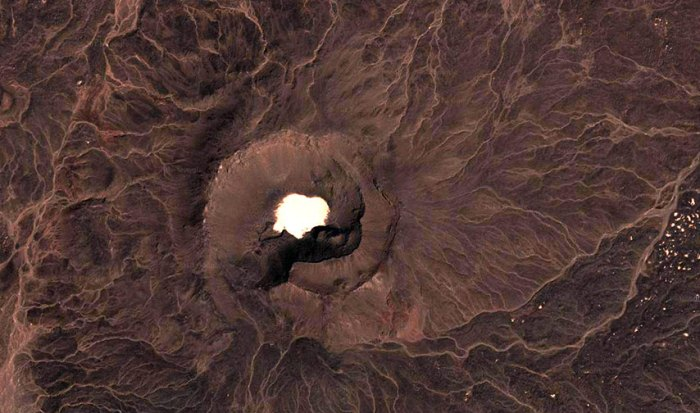 Large vent from Al Haruj with a sand lake.