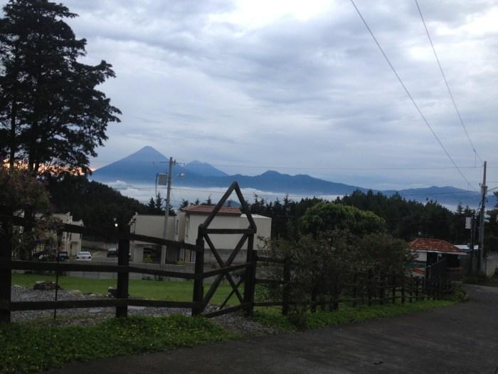 The best view for a morning coffee. Agua and lava domes in the mist with Amatitlán Caldera in between. The slope down is the caldera wall of Amatitlán photographed overlooking our little house. Photograph by Dr. Carmen Morataya de Rehnberg