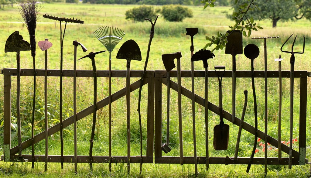 Fence made of garden tools