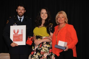 Presentation to Joshua Osbourne (left) from Emily Smith (centre) and Paula Duncan AM (right).