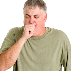 Photo of an older man coughing.