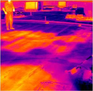 Thermal Imaging image of water standing under a rubber membrane roofing material.