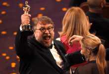 "Guillermo del Toro, winner of the award for best director for ""The Shape of Water,"" celebrates in the audience at the Oscars on Sunday at the Dolby Theatre in Los Angeles."