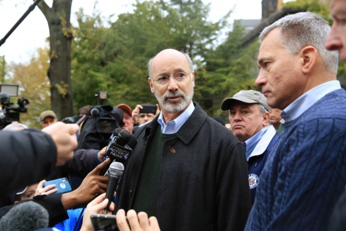Pennsylvania Governor Tom Wolf and Wendell Hissrich (R), Pittsburgh Public Safety Director, speak to media, after a gunman opened fire at the Tree of Life synagogue in Pittsburgh, Pennsylvania, U.S., October 27, 2018.   REUTERS/John Altdorfer