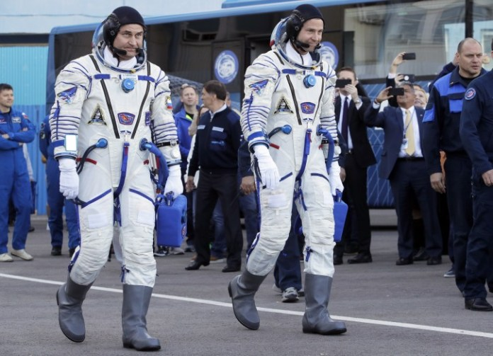 U.S. astronaut Nick Hague, right and Russian cosmonaut Alexey Ovchinin, member of the main crew of the expedition to the International Space Station (ISS), walk prior the launch of Soyuz MS-10 space ship at the Russian leased Baikonur cosmodrome, Kazakhstan, Thursday, Oct. 11, 2018.  (AP Photo/Dmitri Lovetsky, Pool)