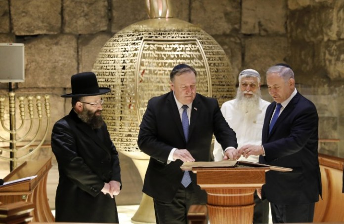 US Secretary of State Mike Pompeo (C), Israeli Prime Minister Benjamin Netanyahu (R) and the Rabbi of the Western Wall Shmuel Rabinovitch (L) visit the Western Wall tunnels synagogue in Jerusalem's Old City during his second day visit to Jerusalem, Israel, 21 March 2019. EPA