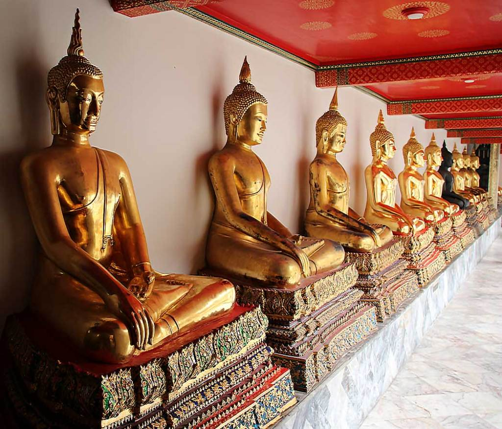 Restored Buddha statues in the courtyard at Wat Pho in Bangkok.