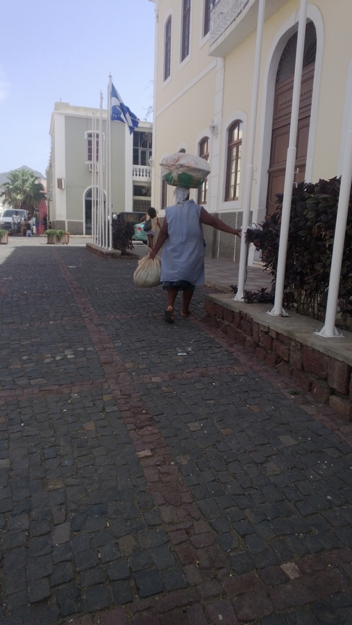 A woman carrying a basket on her head - Mindelo, São Vicente, Cape Verde