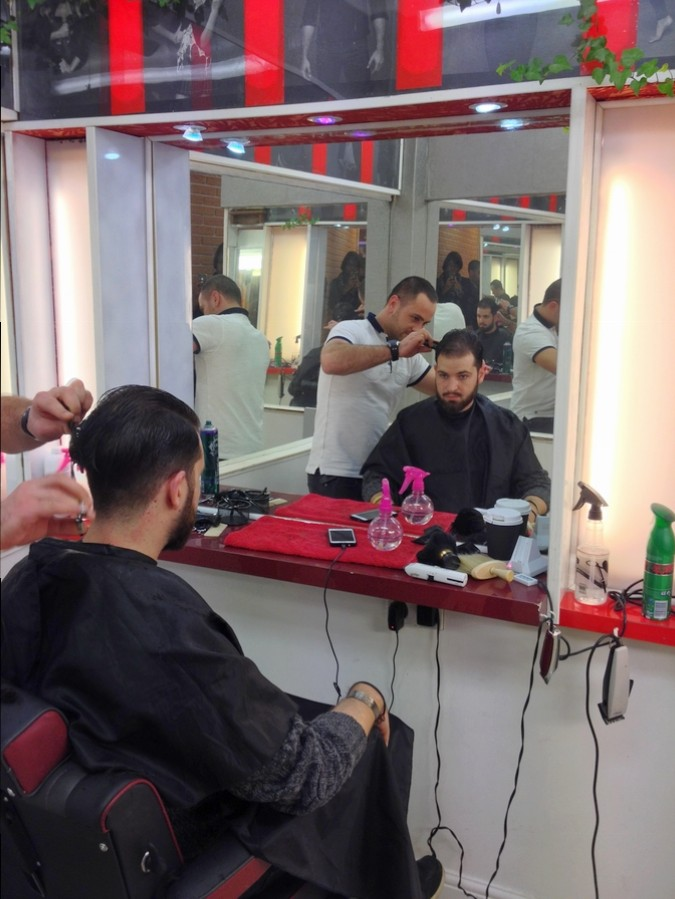Séb getting a hairdo at Roger's - London, England