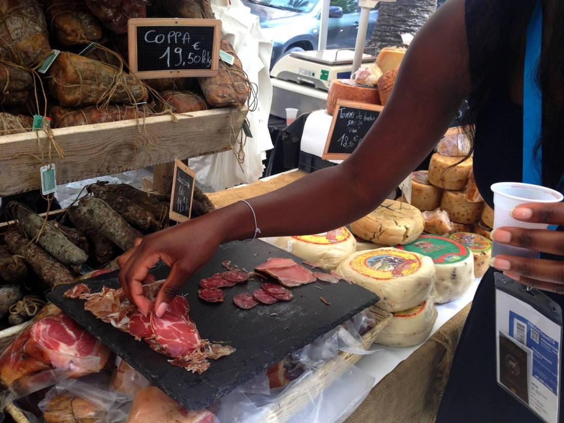 Tasting corsican charcuterie at the U Cintu stand at the market - Ajaccio, Corsica
