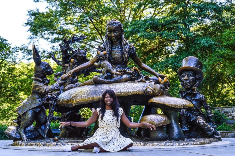 Nath in front of the bronze Alice in Wonderland statue in Central Park - New York, United States