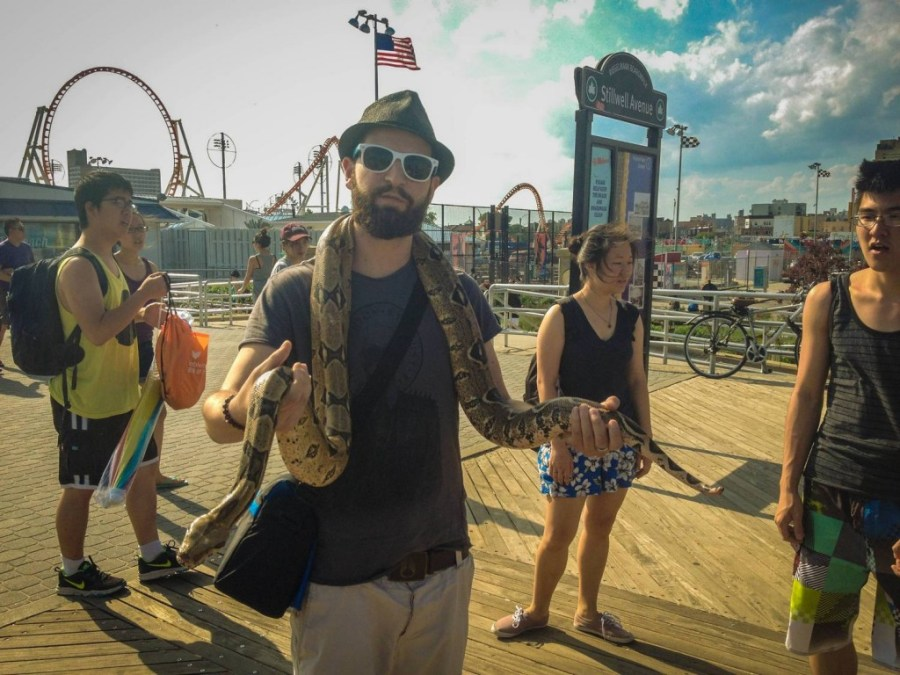 Séb with a snake around his neck in Coney Island - New York City, United States