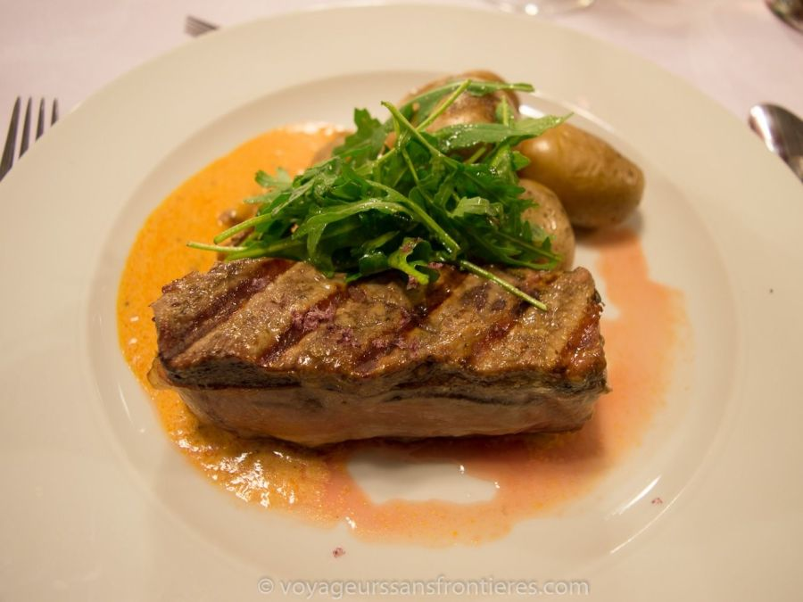 Meat wrapped with bacon with arugula and potatoes at the Vetruse restaurant - Usti nad Labem, Czech Republic