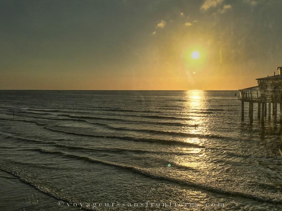 Coucher de soleil sur la plage de Scheveningen depuis la grande roue - La Haye, Pays-Bas