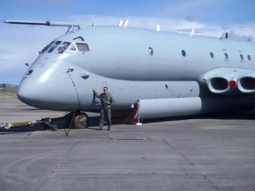 LT Marsh of Patrol Squadron Four poses in front of the Nimrod at RAF Lossiemouth