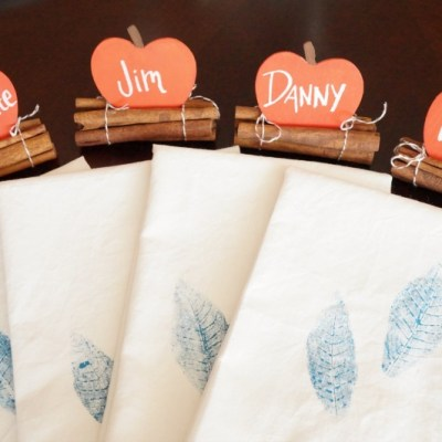 Create a festive table setting for Thanksgiving by creating your own place cards and stamped napkins. by Emily Kennedy, Home & Garden Editor at www.vraimagazine.com