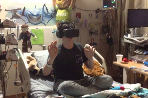 Young male patient in long term hospital playing VR