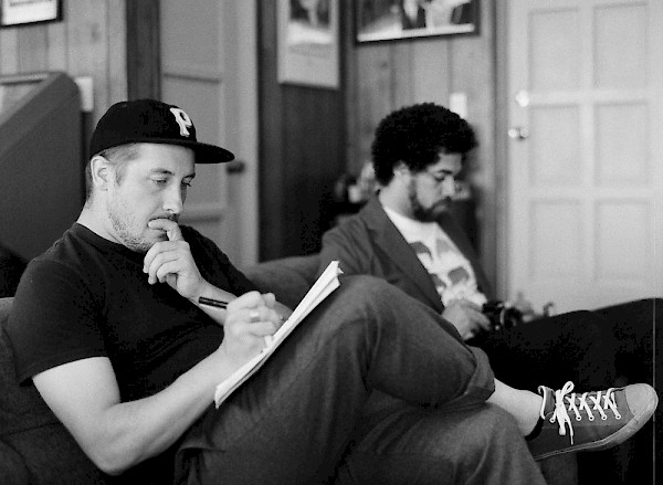 Zach Carothers writing alongside Danger Mouse