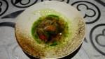 Томат без шкурки, фаршированный козьим сыров в консоме с водорослями