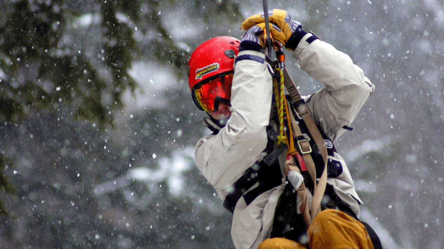 Image of person on zipline in winter at Arbortrek at Smuggler's Notch