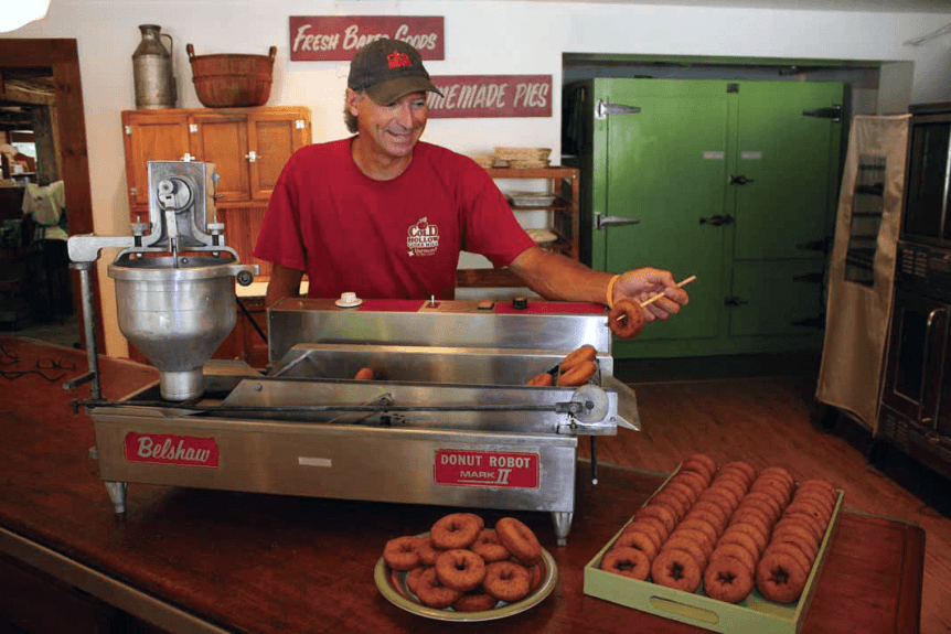 Image of Paul Brown pulling donuts out of fryer