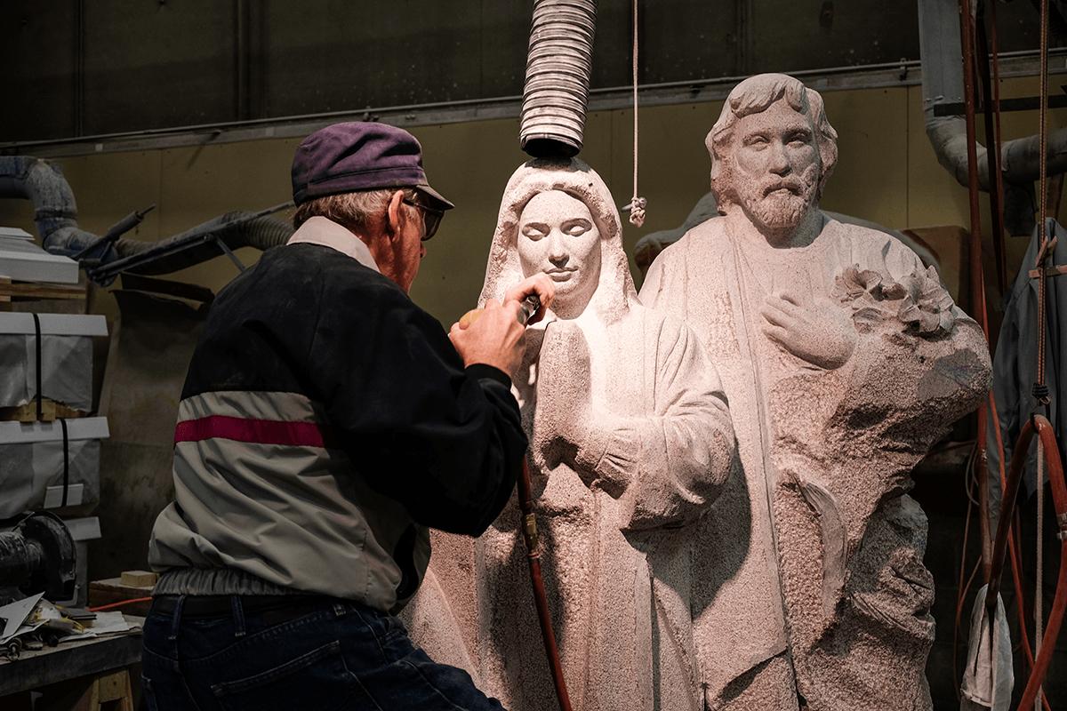 Image of granite sculptor at work.