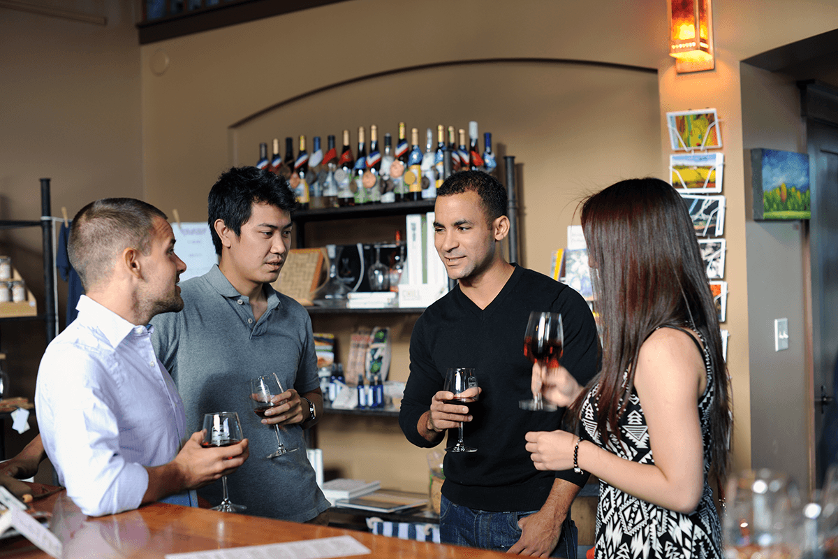 Image of millennials enjoying wine inside the tasting room