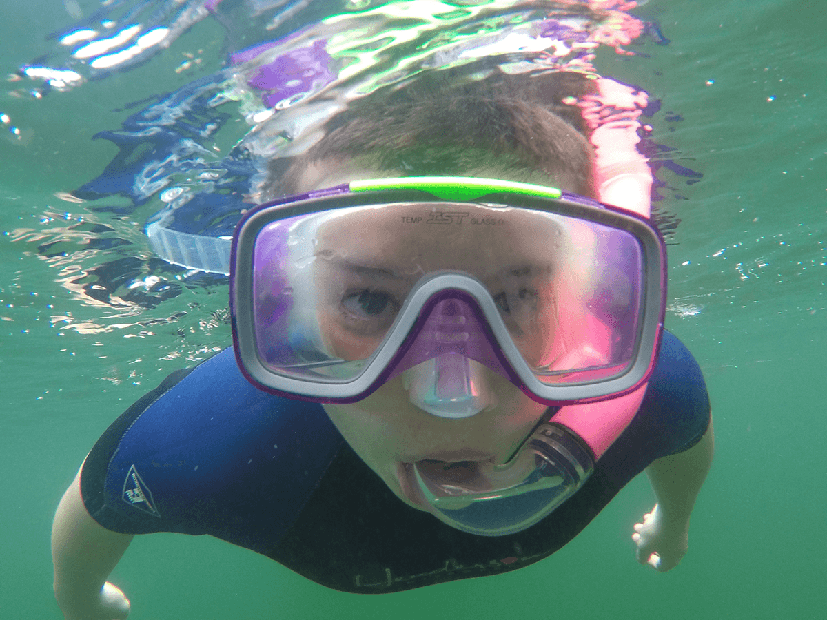 image of child snorkeling