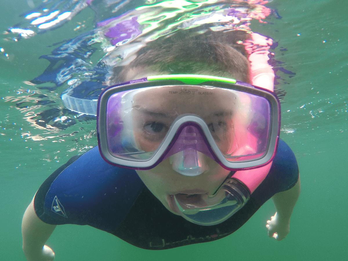 image of child snorkeling