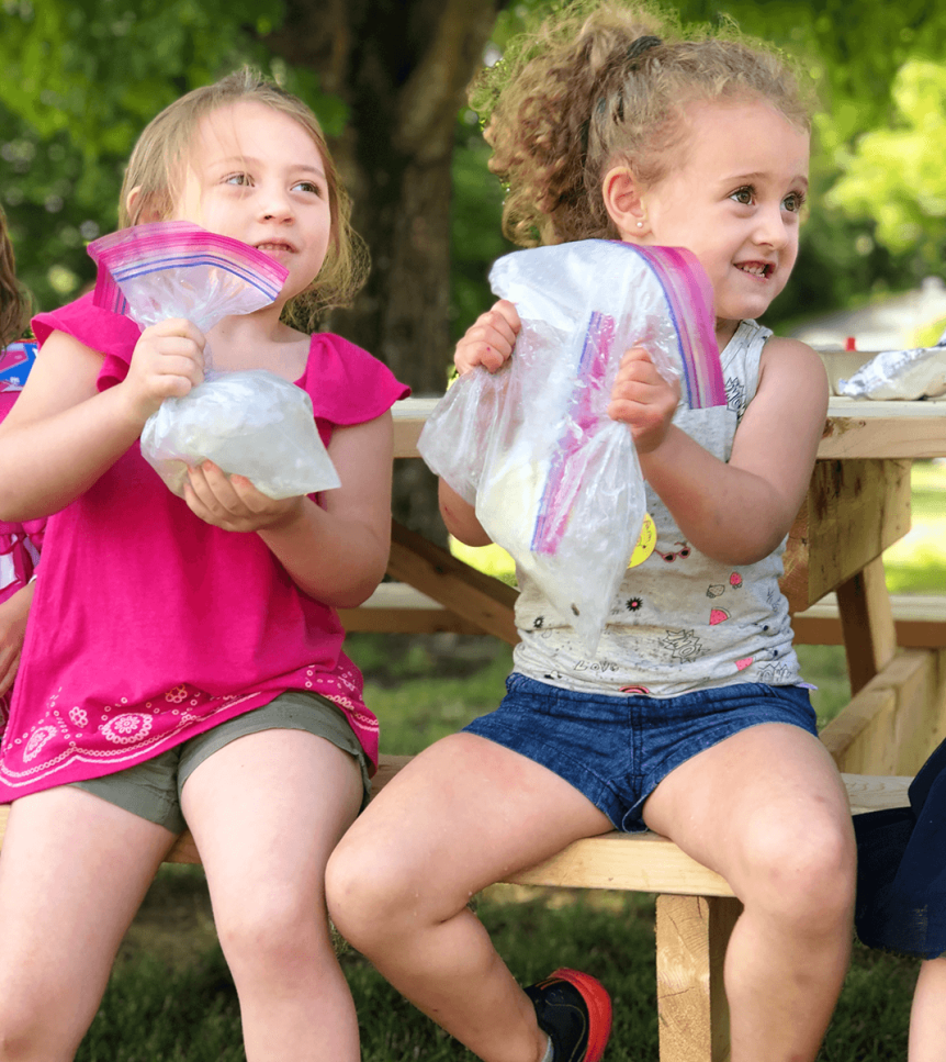 Image of kids holding bags of ice