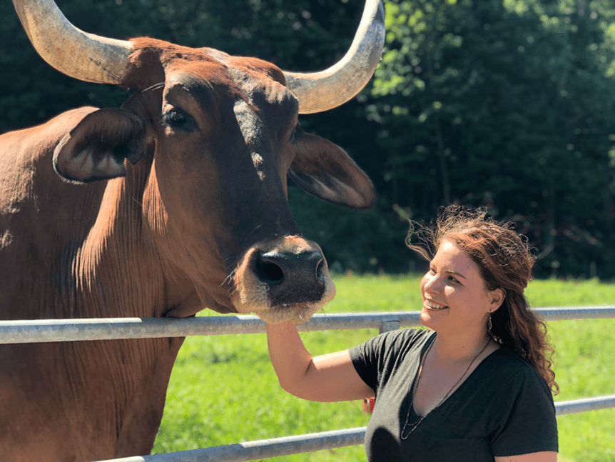 Image of woman and cow