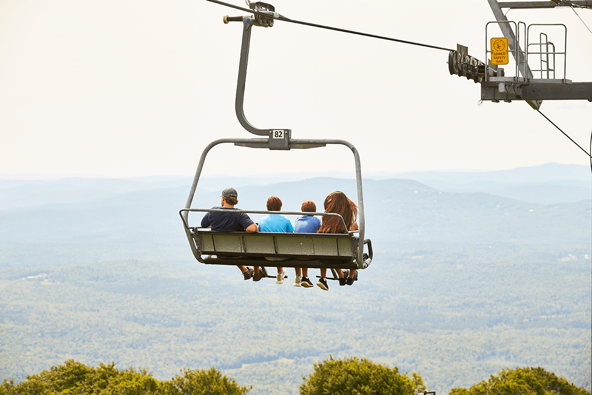 image of family on chairlift in summer
