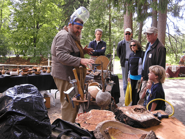 Image of craftsman speaking with visitors