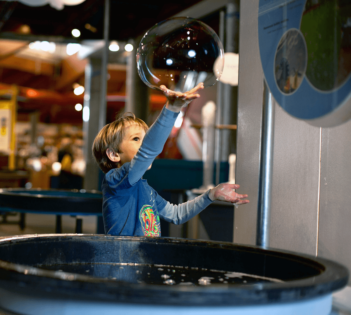 Image of boy playing with a big bubble at Montshire Museum of Science