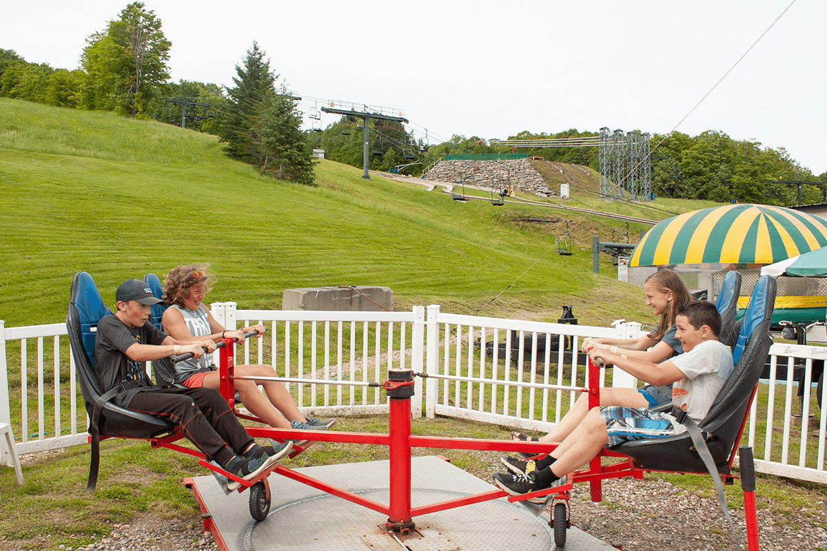 Image of kids on self-powered amusement ride