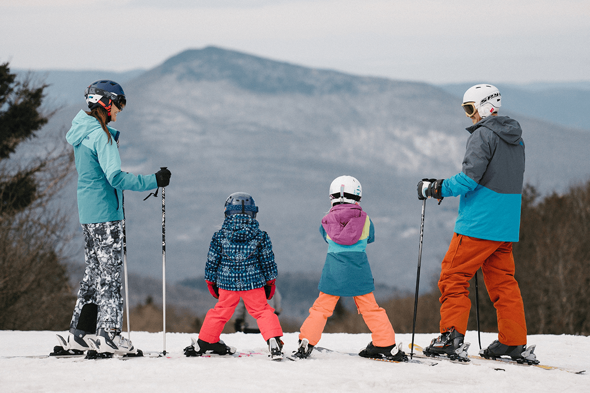 image of family skiing