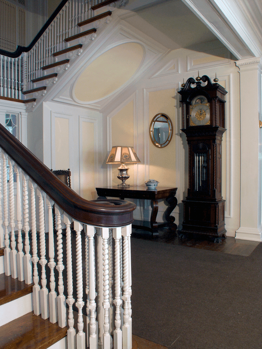 Image of stairway and grandfather clock at Hildene, The Lincoln Family Home