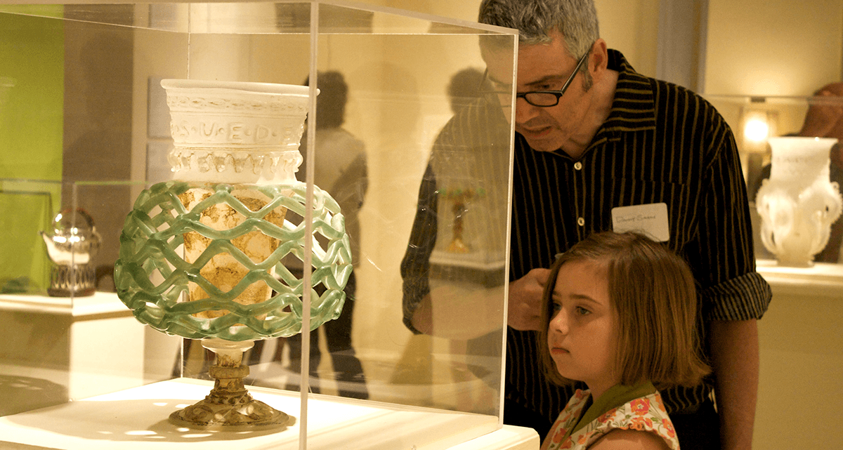 Image of a dad and daughter looking at an artifact at the Bennington Museum
